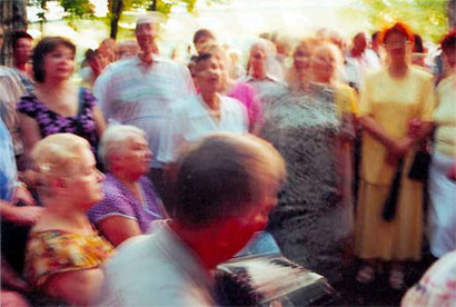Old women and men dancing in Izmailovsky Park in Moscow