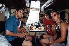 Young people having a meal in their compartment